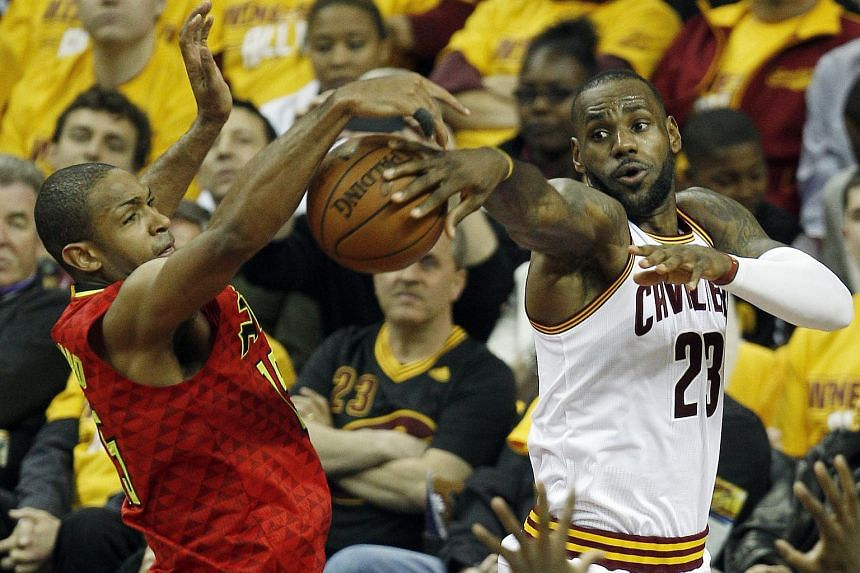 Atlanta Hawks forward Al Horford (left) defends as LeBron James of the Cleveland Cavaliers passes the ball.