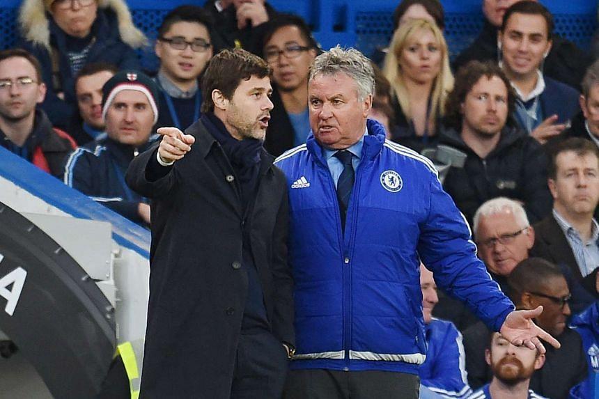 Tottenham Hotspur's Mauricio Pochettino (left) and Chelsea's Guus Hiddink exchange words on the sidelines.