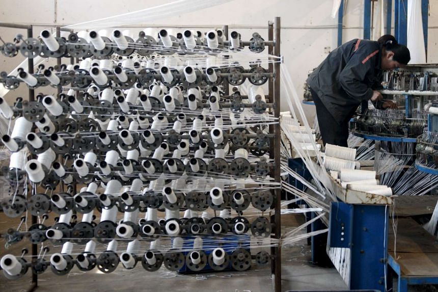 An employee working at a spinning factory in Huaibei, Anhui Province, China, on March 30, 2016.
