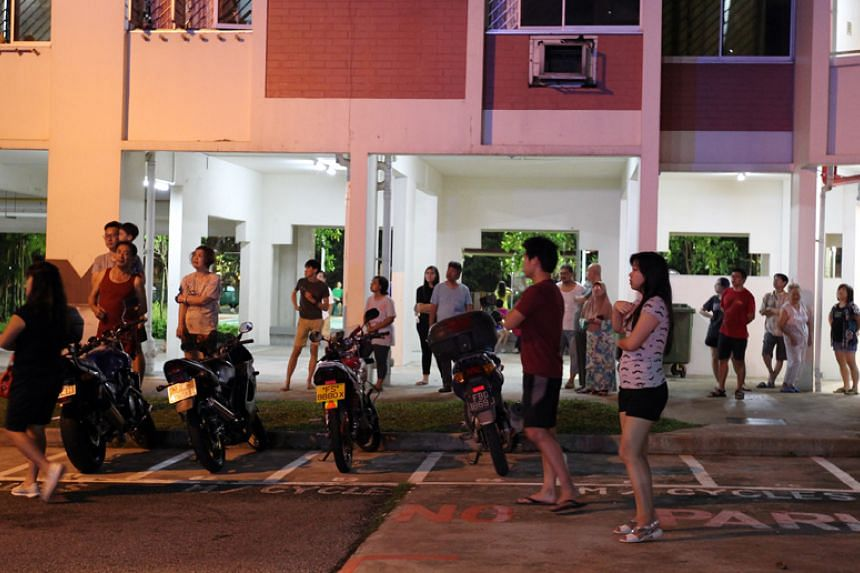Residents of the block where the fire occurred at the scene at Teck Whye Lane on May 3, 2016.