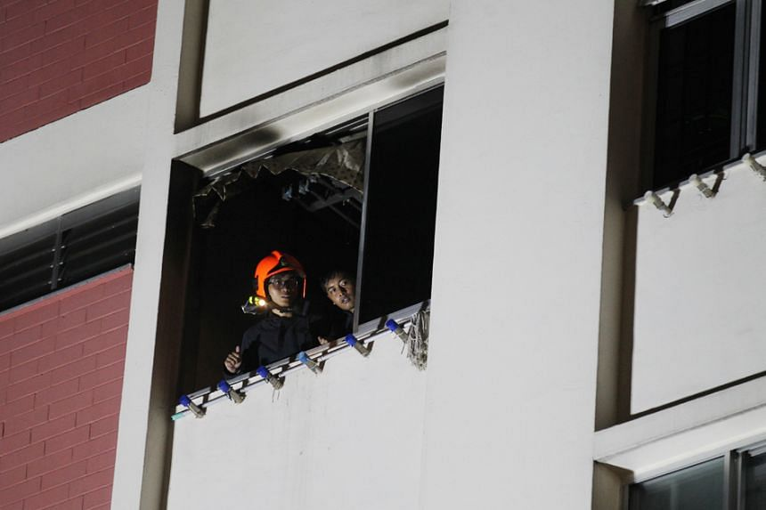 SCDF officers at the scene of the fire at Teck Whye Lane on May 3, 2016.