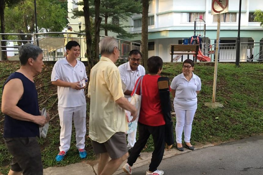 Mr Murali greeting residents and joggers at Bukit Batok Central.