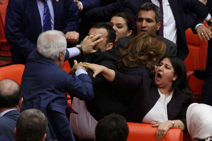 Ruling AK Party and pro-Kurdish Peoples' Democratic Party (HDP) lawmakers scuffle during a debate at the Parliament in Turkey.