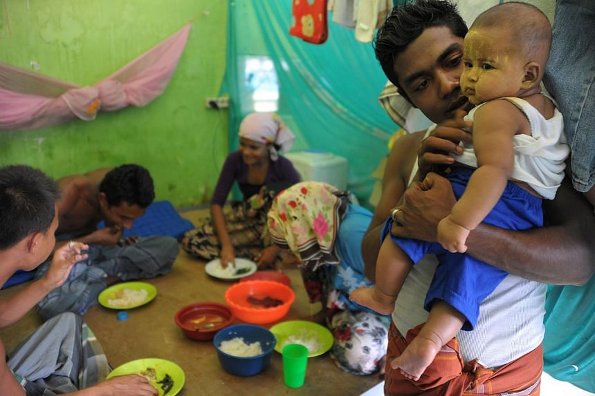 A Rohingya family having food at the Rohingya housing complex in Bayeun in East Aceh, on March 27, 2016.