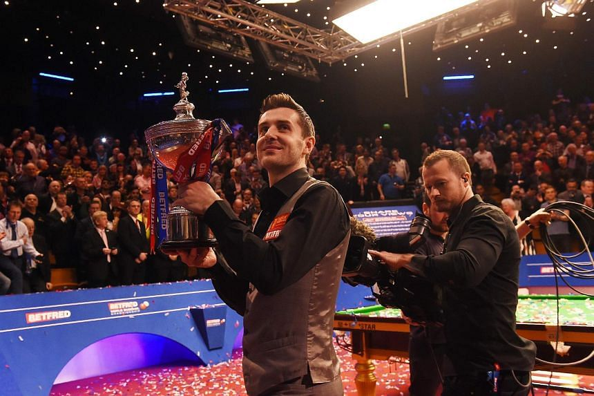 Englishman Mark Selby holding his trophy after beating China's Ding Junhui in the final of the World Snooker Championship on May 2.