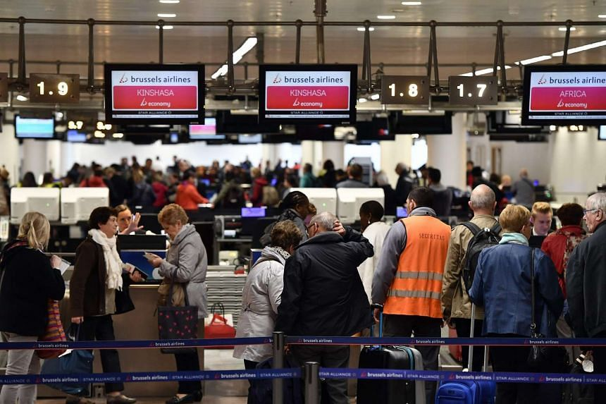 Passengers at the check-in of the departure hall at Brussels Airport on the first day of its partial re-opening on May 2, 2016.