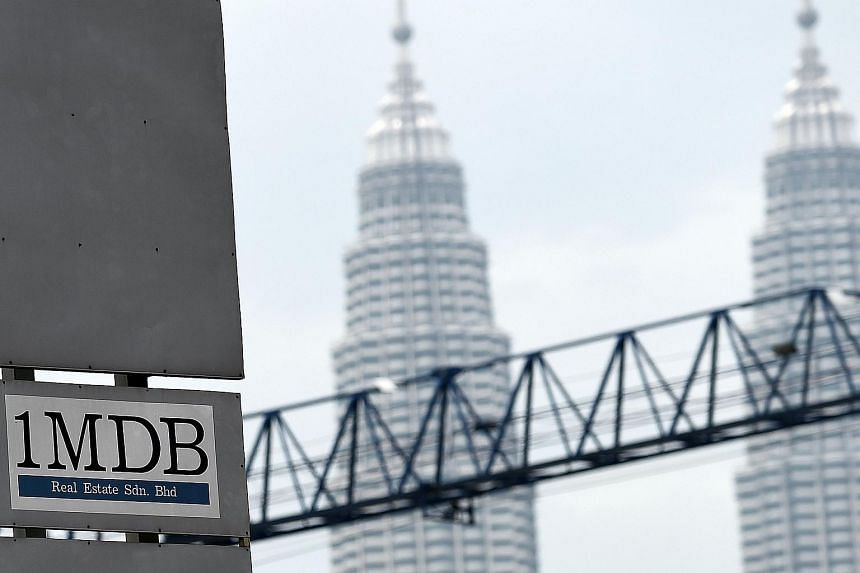Hong Kong bank accounts belonging to several unnamed individuals have been frozen amid global investigations into Malaysia's 1MDB.