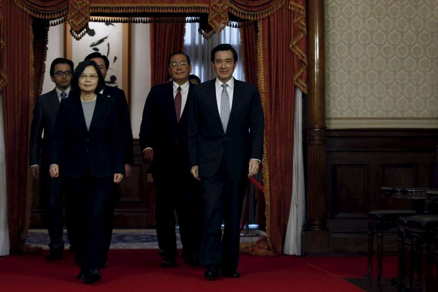 Taiwanese President Ma Ying-Jeou leave with President-elect Tsai Ing-wen after discussing the transfer of power in a meeting in Taipei on March 30, 2016.