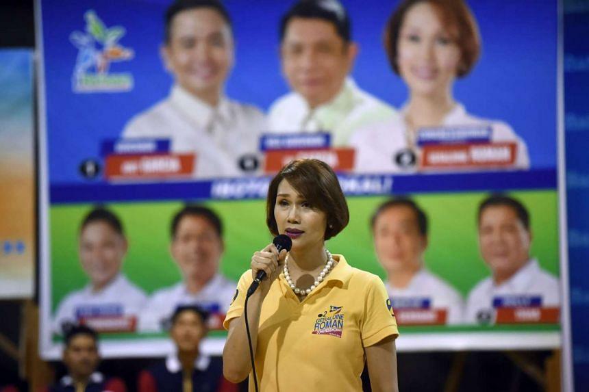 Philippine legislator candidate Geraldine Roman delivering a speech as she campaigns in Orani, Bataan on April 30, 2016.
