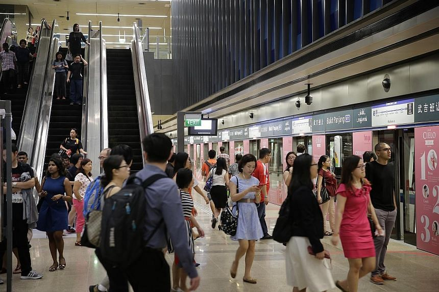 Commuters at Downtown Line 2's Bukit Panjang station a day after its opening on Dec 27 last year. The new line had its first major breakdown yesterday when a train inexplicably applied its emergency brakes. The fault took around half an hour to resol