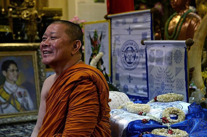 The Leicester-supporting Thai monk Phra Prommangkalachan with the Foxes' banners. He believes the team will do well in next season's Champions League.