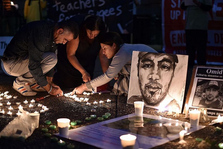 A vigil being held last Saturday for Iranian refugee Omid Masoumali, who died after setting himself on fire on Nauru island.