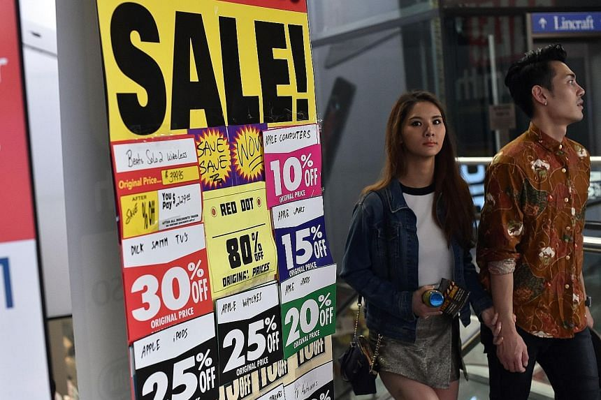 A closing down sale in the central business district of Sydney. Australia is just the latest in the Asian region to feel the chill of deflation as too many goods chase too little demand.