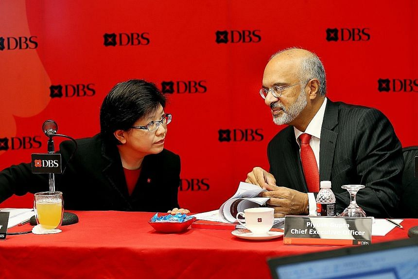 Mr Gupta, DBS chief executive, and chief financial officer Chng Sok Hui at the press briefing yesterday. Revenue rose 5 per cent to $2.87 billion, as net interest income grew 8 per cent to $1.83 billion, on the back of better net interest margin and