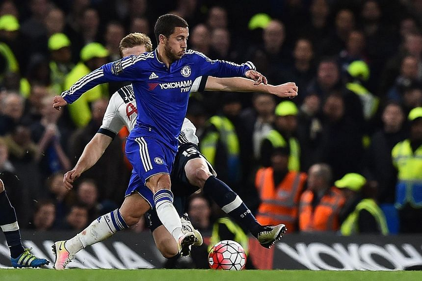 Spurs' Eric Dier (back) fouls Chelsea's Eden Hazard during the ill-tempered game at Stamford Bridge. The match ended with 12 players booked.