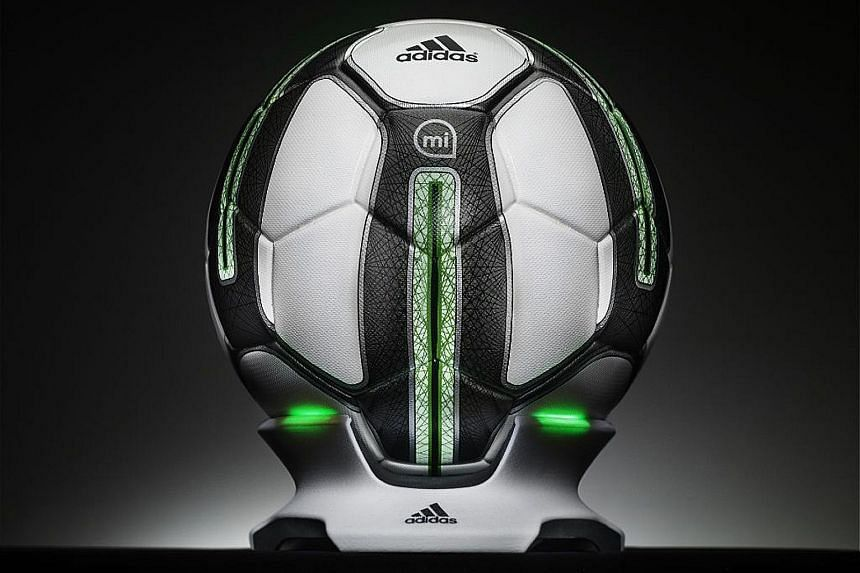 The adidas miCoach Smart Ball comes with a futuristic wireless charging dock.