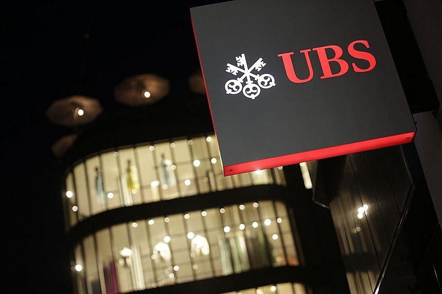 A branch of the UBS Group in Zurich. Switzerland's biggest bank yesterday reported net profit for the first three months fell by 64 per cent to 707 million Swiss francs (S$999 million).