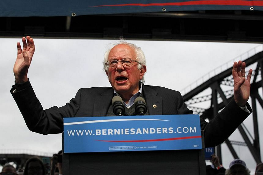 US Democratic presidential candidate Bernie Sanders addressing the crowd during a campaign rally at the Big Four Lawn park on May 3, 2016, in Louisville, Kentucky.