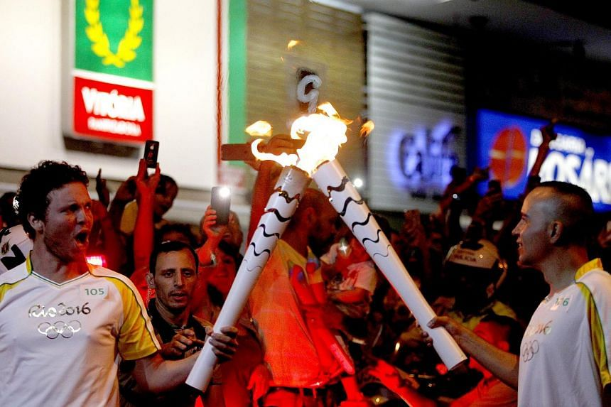 The Olympic Flame arrives at Our Lady of Fatima Church in Brasilia.