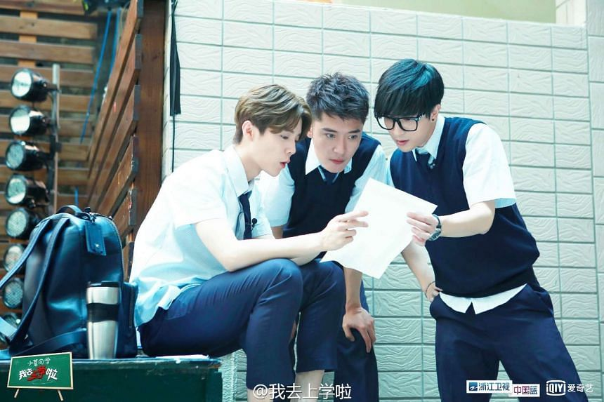 Singer Lu Han (left), actor Feng Shaofeng (centre) and singer Xue Zhiqian filming the reality show Back To School.