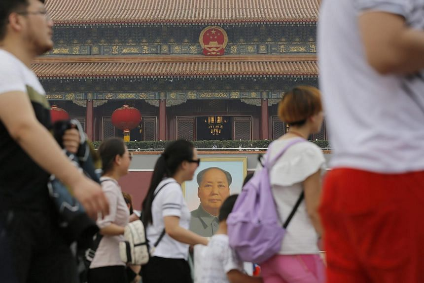 Tourists gather in front of the Tiananmen Gate during Labour Day in Beijing.