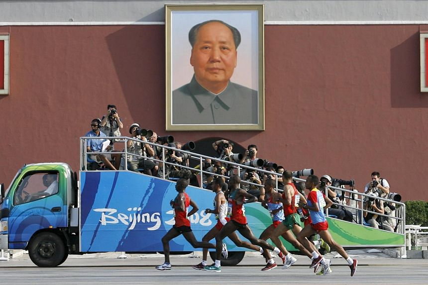 Competitors running in front of the Tiananmen Gate during the men's marathon at the Beijing 2008 Olympics.