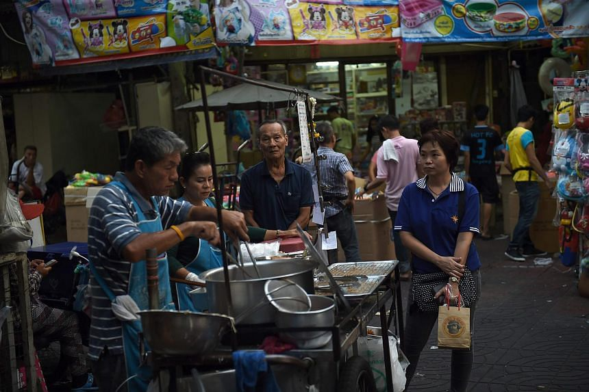 People buying food from a street vendor in Bangkok's Chinatown on April 12.