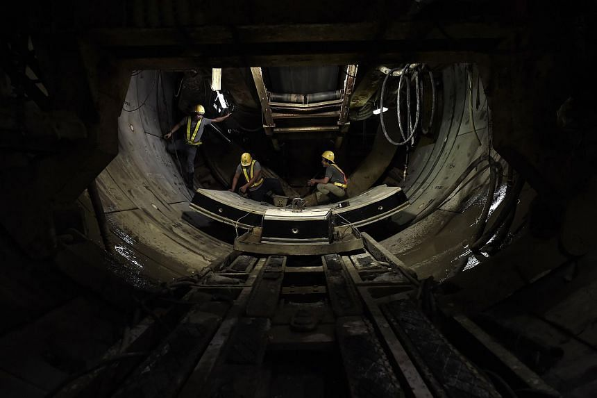 Workers preparing curved concrete segments forming the inner surface of a tunnel being dug along the extension of the metro into Bangkok's historic Chinatown, on March 11.