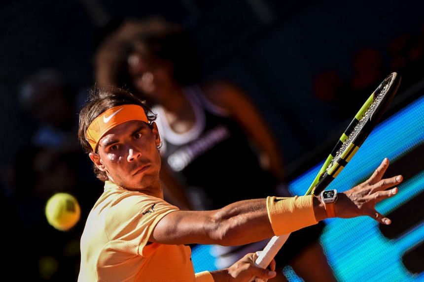 Rafael Nadal returns a ball to Andrey Kuznetsov during the Madrid Open tournament at the Caja Magica (Magic Box) sports complex in Madrid, on May 3, 2016.