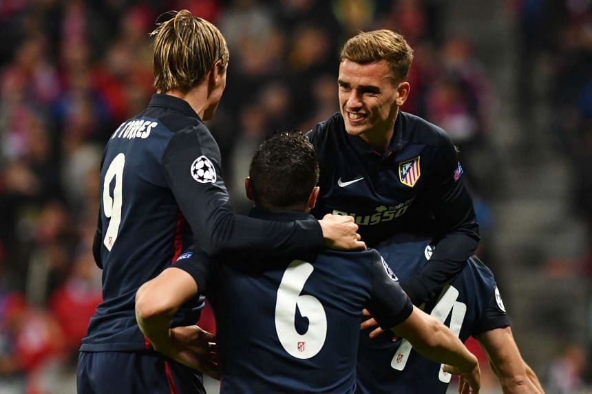 Atletico Madrid's French forward Antoine Griezmann (right) celebrating with his team-mates after scoring against Bayern Munich during the UEFA Champions League semi-final, on May 3, 2016.
