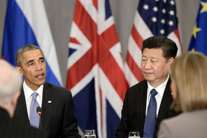 Xi Jinping (right) listens to Barack Obama (left) during the Nuclear Security Summit at the Walter E. Washington Convention Centre on April 1, 2016.
