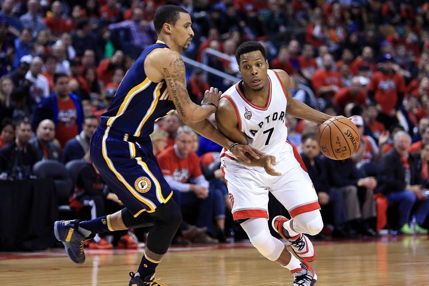 Kyle Lowry (right) of the Toronto Raptors in action against George Hill of the Indiana Pacers during the 2016 NBA Playoffs on May 1.