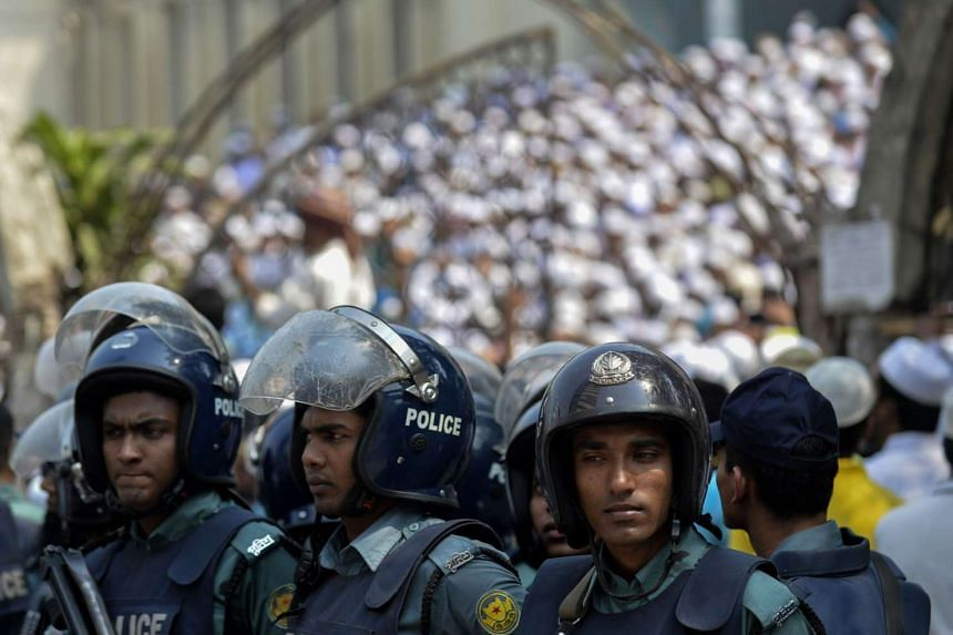 Bangladeshi police standing guard amid a protest by hardline Islamists outside the national mosque in Dhaka on March 25.
