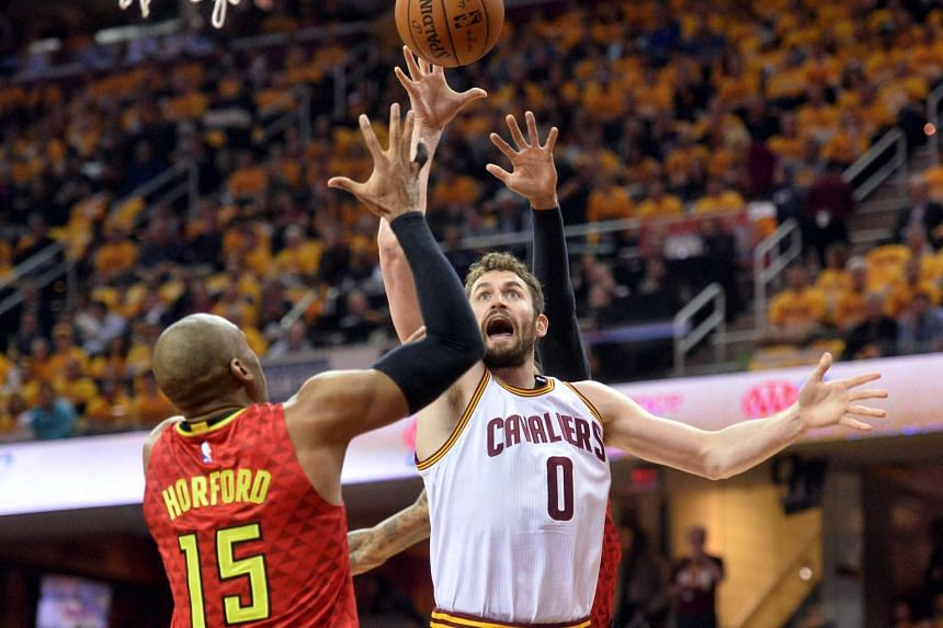 Cleveland Cavaliers' Kevin Love (right) shoots over Atlanta Hawks' Al Horford in Game 2 of the second round of the NBA Playoffs at Quicken Loans Arena.