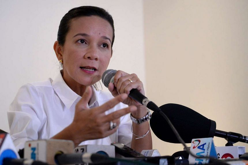 Philippine presidential candidate Senator Grace Poe gestures during a press conference in Manila on May 5, 2016.
