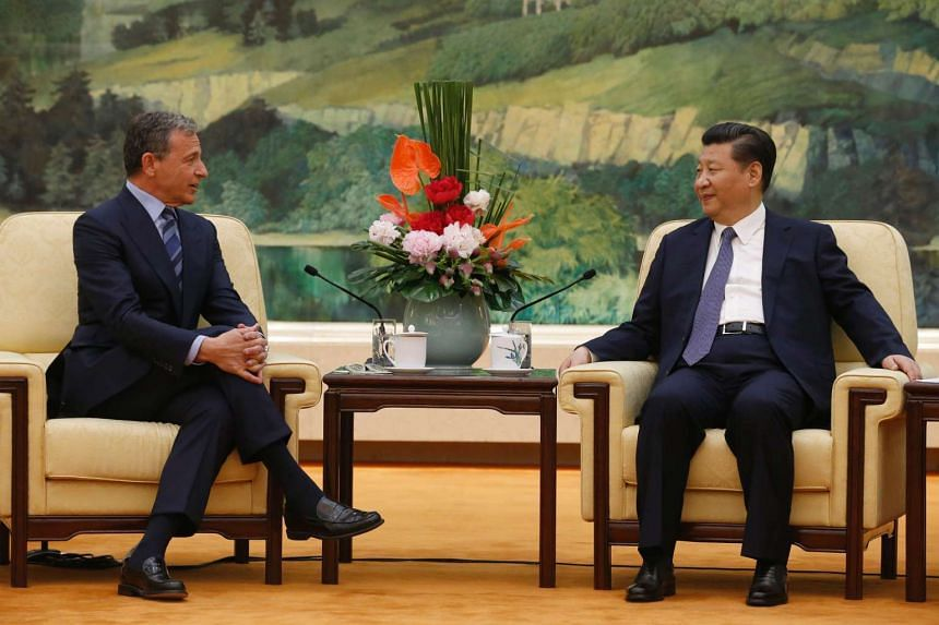 China's President Xi Jinping (right) talks with Chief Executive Officer of Disney Bob Iger as they meet at the Great Hall of the People in Beijing on May 5, 2016.