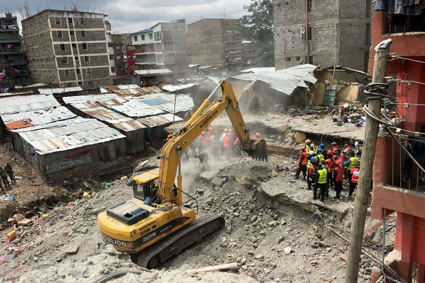 Rescue workers use a bulldozer as they search for survivors in Huruma, in the rubble of a six-storey building that collapsed in Nairobi.