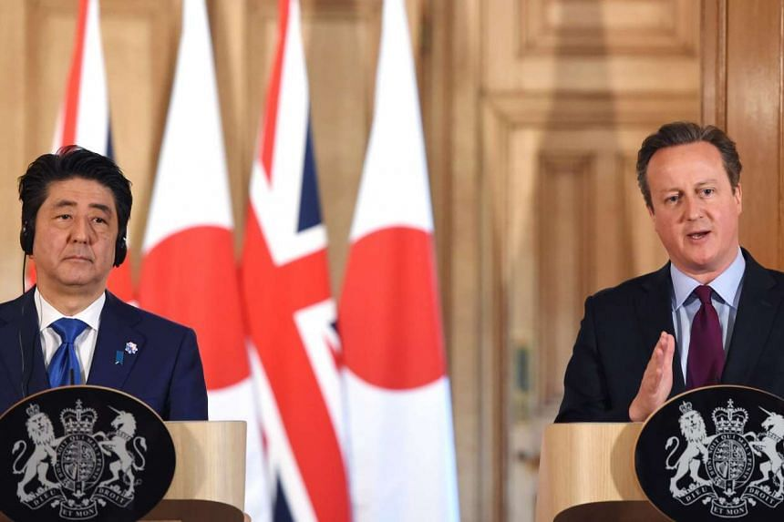 British Prime Minister David Cameron (right) and Japanese Prime Minister Shinzo Abe, at a press conference in 10 Downing Street in London, on May 5, 2016.