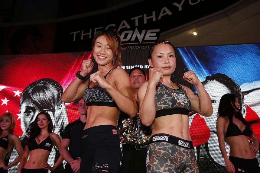 Singapore's Angela Lee (left) and Japan's Mei Yamaguchi during the weigh-in for One Championshp's Ascent to Power fight night.