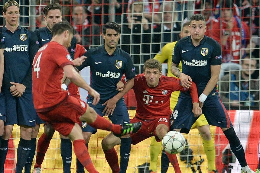 Bayern Munich's Xabi Alonso opened the scoring with a free kick, after the flight of the Spanish midfielder's shot was altered by a deflection off Atletico Madrid defender Jose Gimenez. Atletico forward Antoine Griezmann equalised with a valuable awa