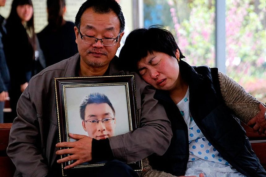 The parents of Mr Wei Zexi, a computer science major at Xidian University in Shaanxi province who died of a rare form of cancer, outside a funeral home last month.