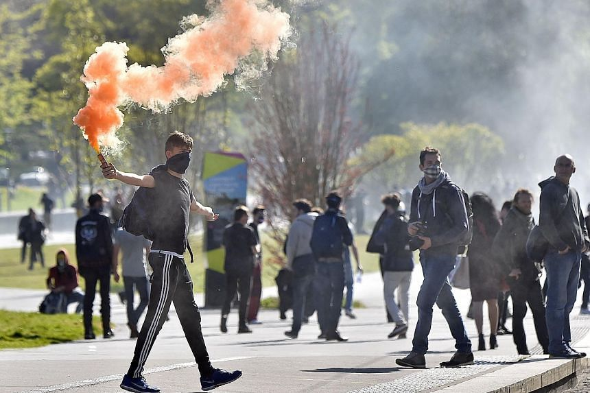 French workers and students protesting in the western city of Nantes on Tuesday against the Socialist government's planned labour law reforms. The proposals have divided the government and raised hackles in a country where the people are accustomed t