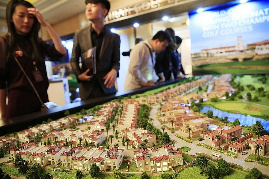 A property showcase in Beijing. Developers are among a growing number of Chinese companies seeking higher valuations by moving their listings from New York or Hong Kong to mainland exchanges.