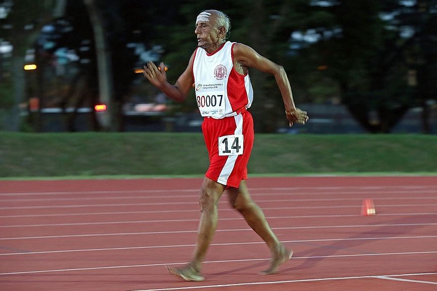 Competing without footwear, T. D. Rajendran, the 80-year-old managing director of a herb company in Tamil Nadu, India, on his way to winning the 5,000m race walk in the men's 80-84 category at the Asia Masters Athletics Championships at Kallang yeste