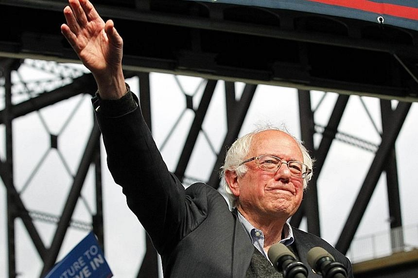 Mr Sanders in Louisville, Kentucky, on Tuesday. Despite her loss in Indiana, Mrs Clinton still maintains a lead of 2,220 delegates over Mr Sanders' 1,449.