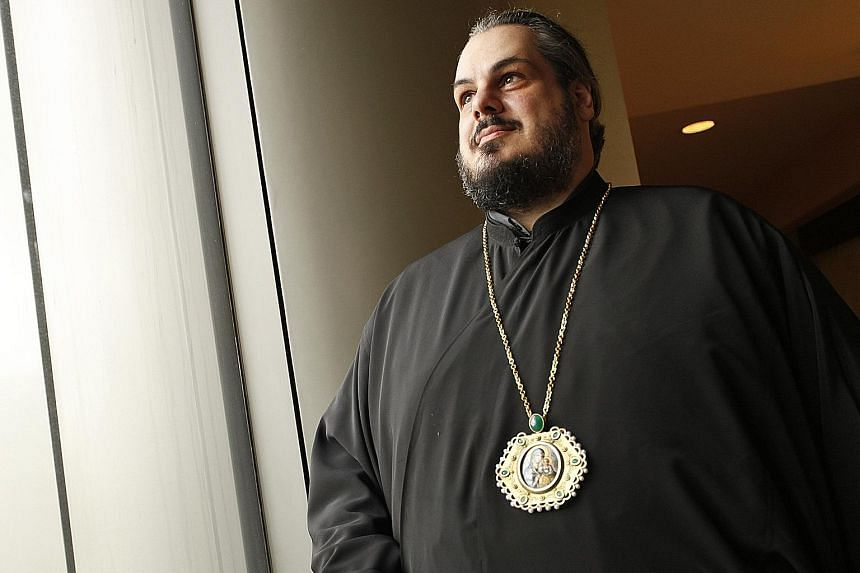 Metropolitan Konstantinos Tsilis, 44, was a print and radio journalist for 15 years before he became a priest.