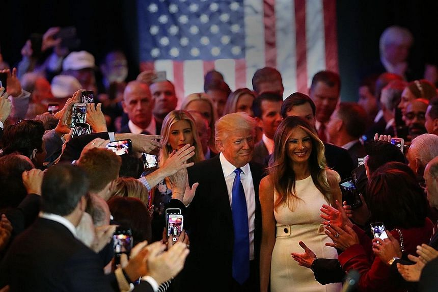 US Republican presidential candidate Donald Trump and his wife Melania arriving to speak to supporters at Trump Tower in Manhattan following his victory in the Indiana primary on Tuesday. Mr Trump beat Mr Cruz 53 per cent to 37 per cent, forcing the