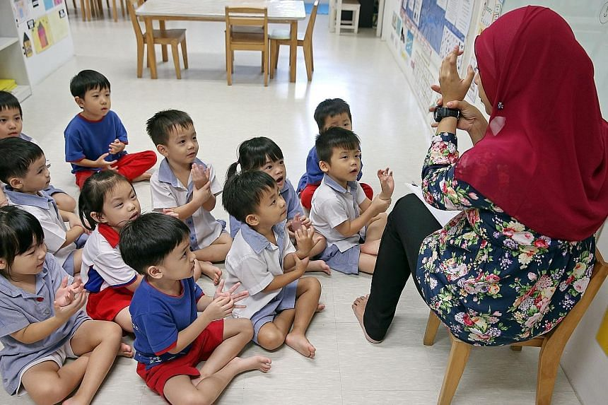 A pre-school teacher with her Nursery 2 class at PCF Sparkletots Preschool@ Fengshan. The Early Childhood Development Agency has launched a programme to help pre-school teachers progress in their careers and take on larger roles. The scheme will put