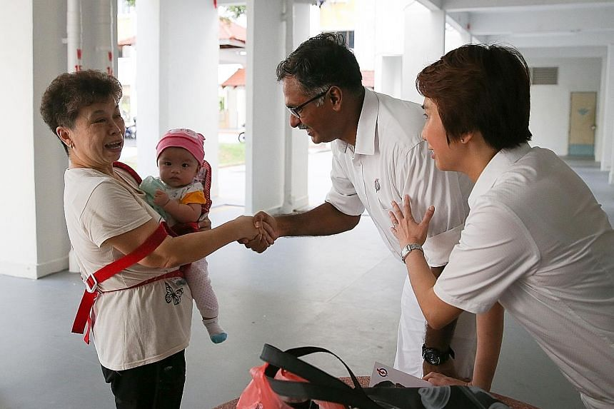Mr Murali, accompanied by South West District Mayor Low Yen Ling, meeting a resident on the campaign trail yesterday. He says his discussions with residents has helped him to refine details of his plans for the area.