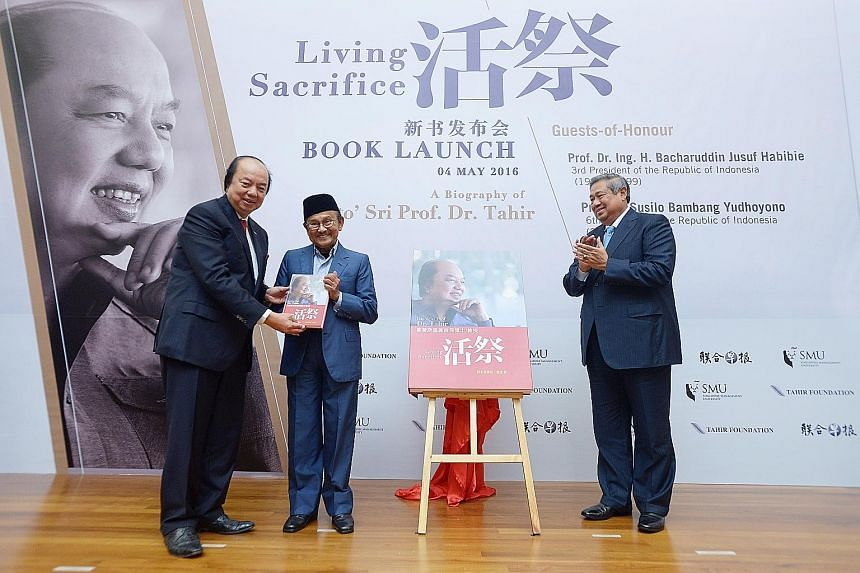 From left: Mr Tahir presenting copies of his book to former Indonesian presidents Dr Habibie and Dr Yudhoyono yesterday. The book traces the Indonesian billionaire's rags-to-riches journey, and he hopes it will inspire his countrymen.